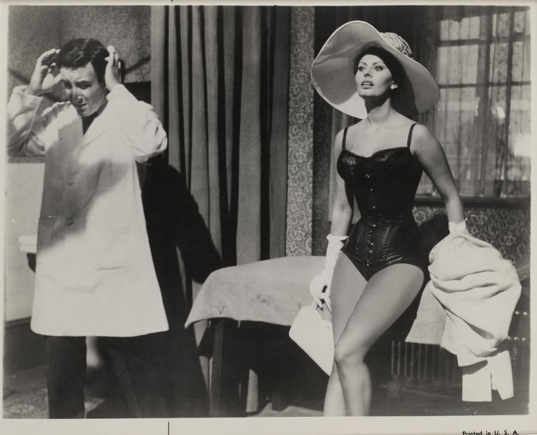 Original black and white production still from The Millionairess 1960. The film was directed by Anthony Asquith. And starred Sophia Loren, Peter Sellers and Alastair Sim. This piece is conservation framed in an Obeche wood frame with card mounts