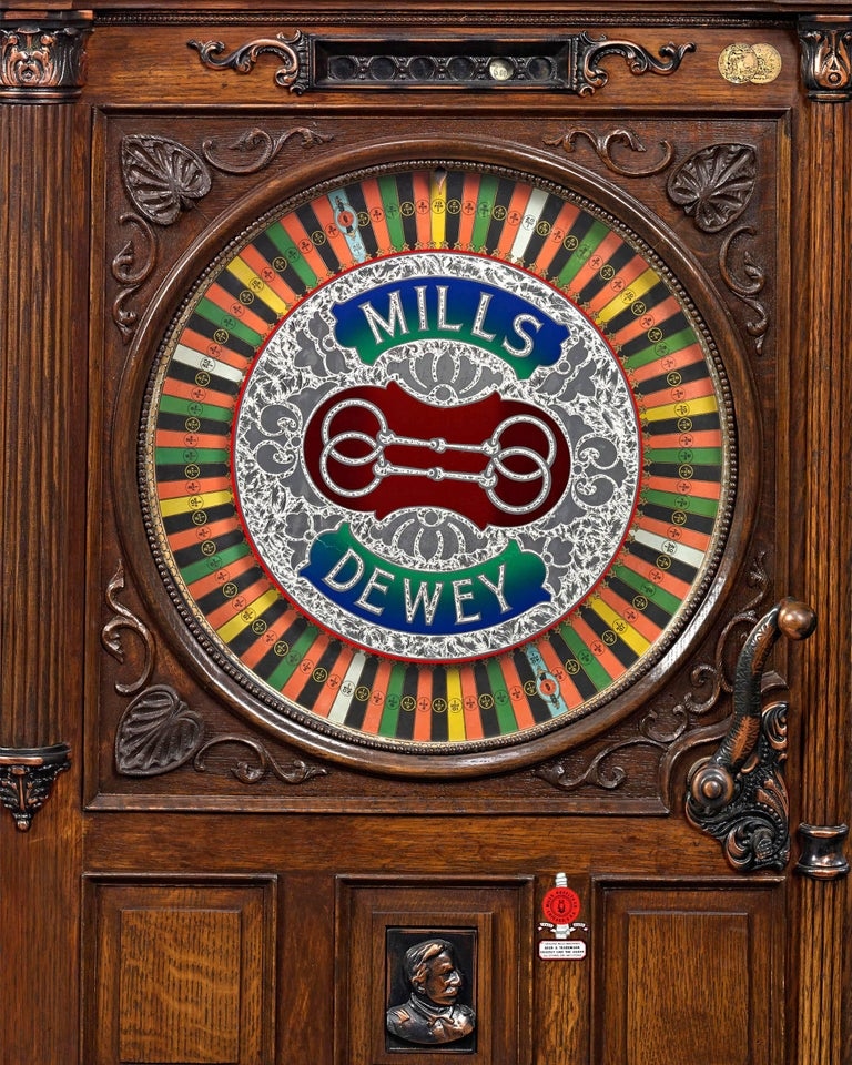 An astonishing artifact of Americana, this Dewey-Chicago triplet floor model slot machine is the only one of its kind known to exist today. Created by the Mills Novelty Company of Chicago, this remarkable machine is actually three slot machines in