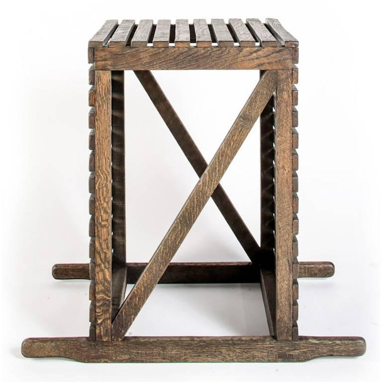 Rustic occasional or spot table in English oak, bench made in Great Britain. Based on the crates used for transporting museum pieces, the table has