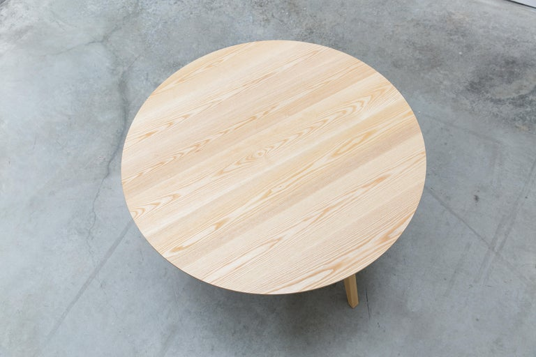 The tapered leg and beveled top give the Nicole table a distinct lightness; and rather than using a bulky skirt that wraps around the perimeter of the table, the legs come together in the centre. Available as a full scale dining table or in varying