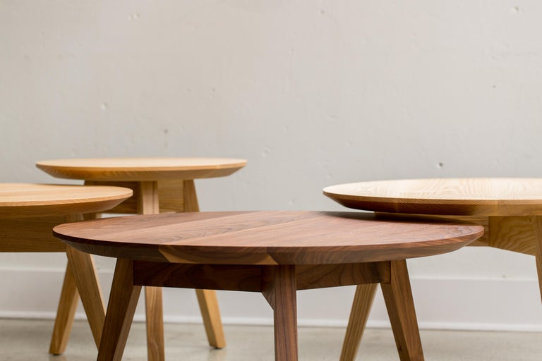 The tapered leg and beveled top give the Nicole table a distinct lightness, and rather than using a bulky skirt that wraps around the perimeter of the table, the legs come together in the centre. Available as a full scale dining table or in varying