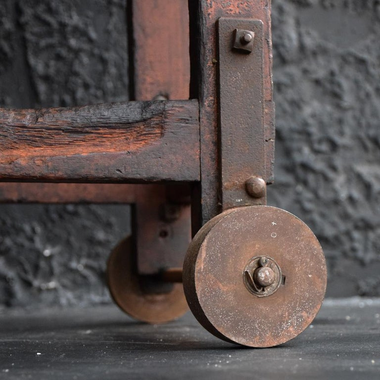 Recently uncovered in an empty mill factory in Durham England, this unique decorative and functional aged mill trolley would have been used for transporting and moving heavy metal objects. It's very well-structured in form, Primitive in appeal but