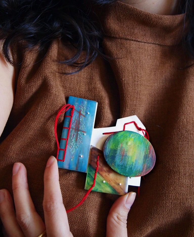 'The Palace of the Bees' brooch, based on a narrative poem and sketch study painting created by the artist, this one-of-a-kind brooch is loaded with symbolism and meaning.    Layers of Sterling Silver, hand textured/painted resin, as well as color