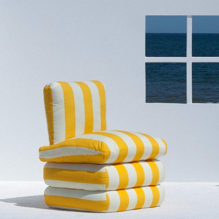 Inspired by the relaxed glamour of the 1960's Italian Riviera, our new Pillow Chair physically embodies the longing for lazy summer days with a comfortable, fully upholstered chair in colorful and classic stripes.   The upholstered shape brings to
