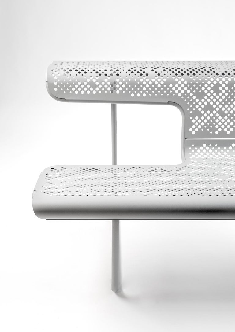 Alfredo Haberli is a great admirer of designs by Oscar Tusquets and Lluis Clotet. As a tribute to the Catalano and Perforano Benches, he designed the Suizos Benches Collection in perforated painted steel. Out of all the benches, The Poet Bench has