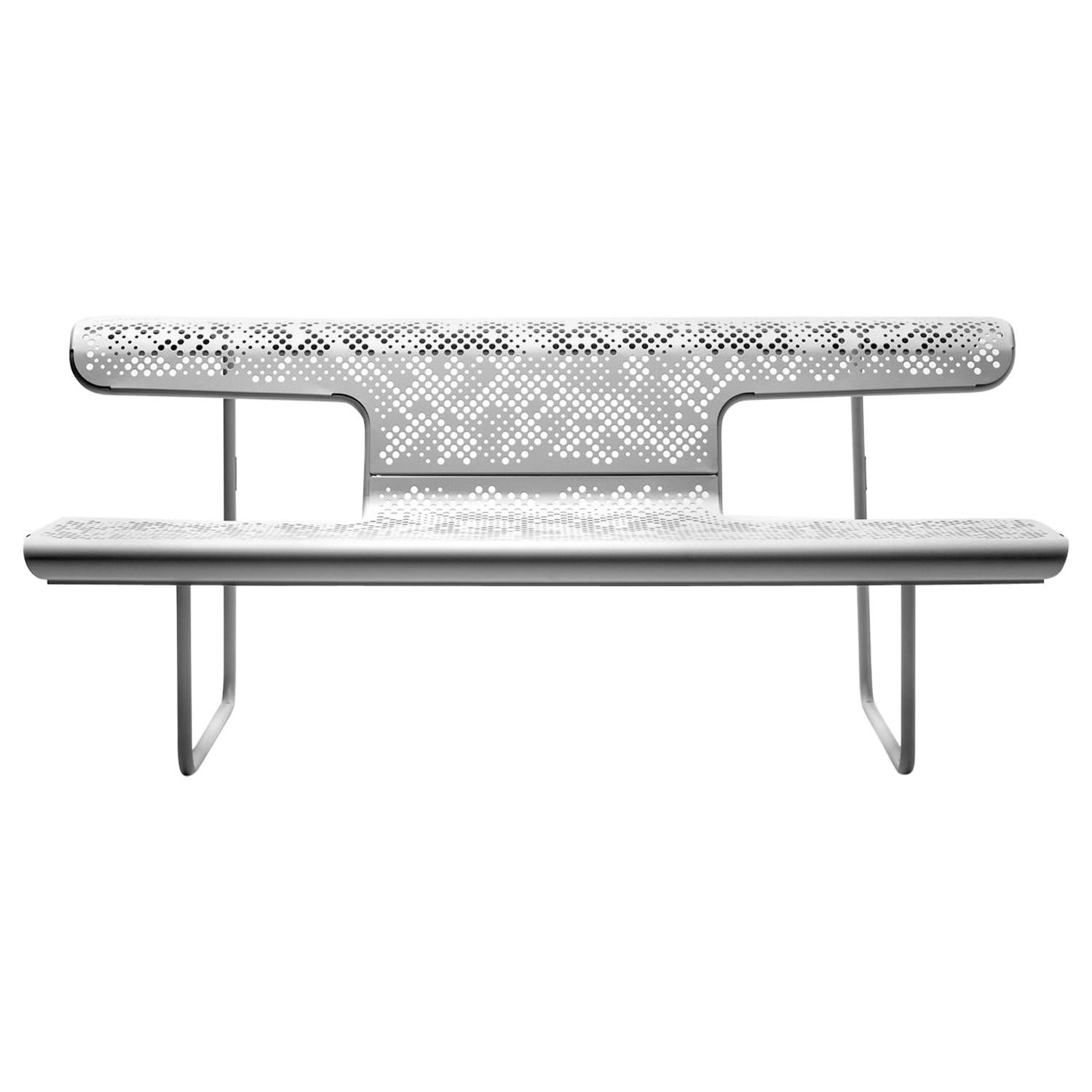 Public bench in perforated steel designed by Alfredo Häberli