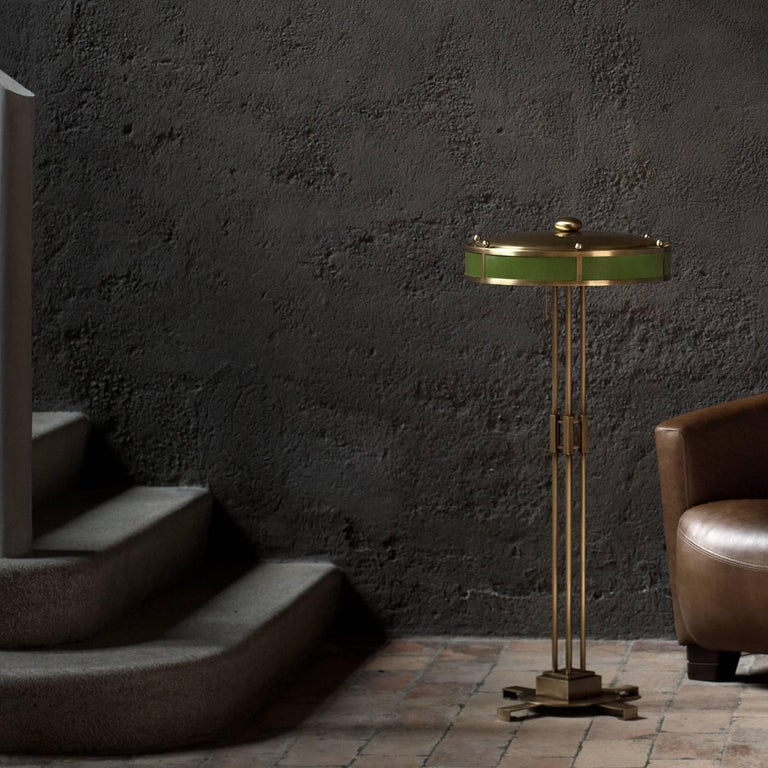 With substantial proportions with a delicate shade, this floor lamp has an allure that will bring glamour to any surroundings. Made of brass-plated steel and inspired by the Italian design of the early 1930s, four parallel tubular rods are supported