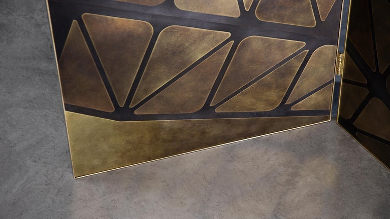 A three-panelled standing screen in patinated brass, featuring our metal marquetry finish. Each element is cut, finished, then carefully reassembled by hand. The first of our Seven Sisters of Tyne collection, a series of seven screens each inspired