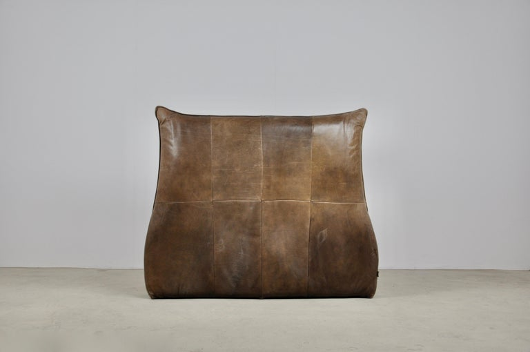 Leather armchair. Wear and tear due to time and the age of the armchair.