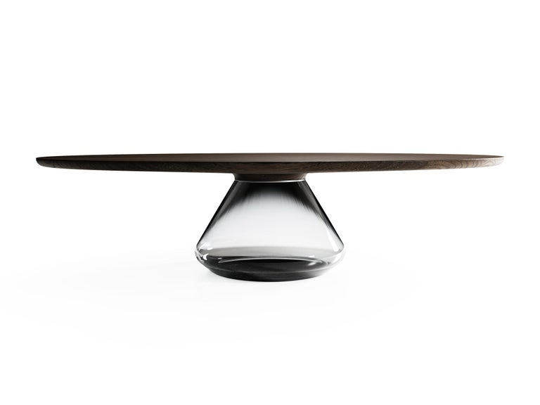 The Smoky Eclispse I,limited edition coffee table by Grzegorz Majka Limited Edition of 8 Dimensions: 54 x 48 x 14 in Materials: Glass, oak  The total eclipse of every interior? With this amazing table everything is possible as with its