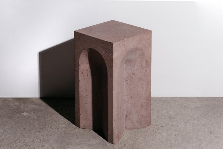 The source side table no. 2 by A Space is handcrafted from pink tuff, a light, porous rock formed by the consolidation of volcanic ash, in a limited edition of 5.  This collection is inspired by antiquity, architecture, craftsmanship, and the