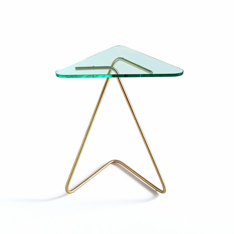 Thetriangle side table by Rita Kettaneh  Dimensions: The base: brushed stainless steel plated with brass  optionally plated with copper or brass  The top: acrylic Materials: H 49.5 x W 41 x D 9.5 cm Weight: 2.6 Kg  Colors and