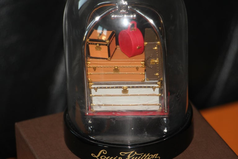 This Louis Vuitton VIP Trunk Bag Trolley Snow Globe was commissioned in 2010, extremely limited, a collector's item.. It features a porter trolley with various Vuitton suitcase, as well as hat trunks and steamer trunks .  It is a very limited