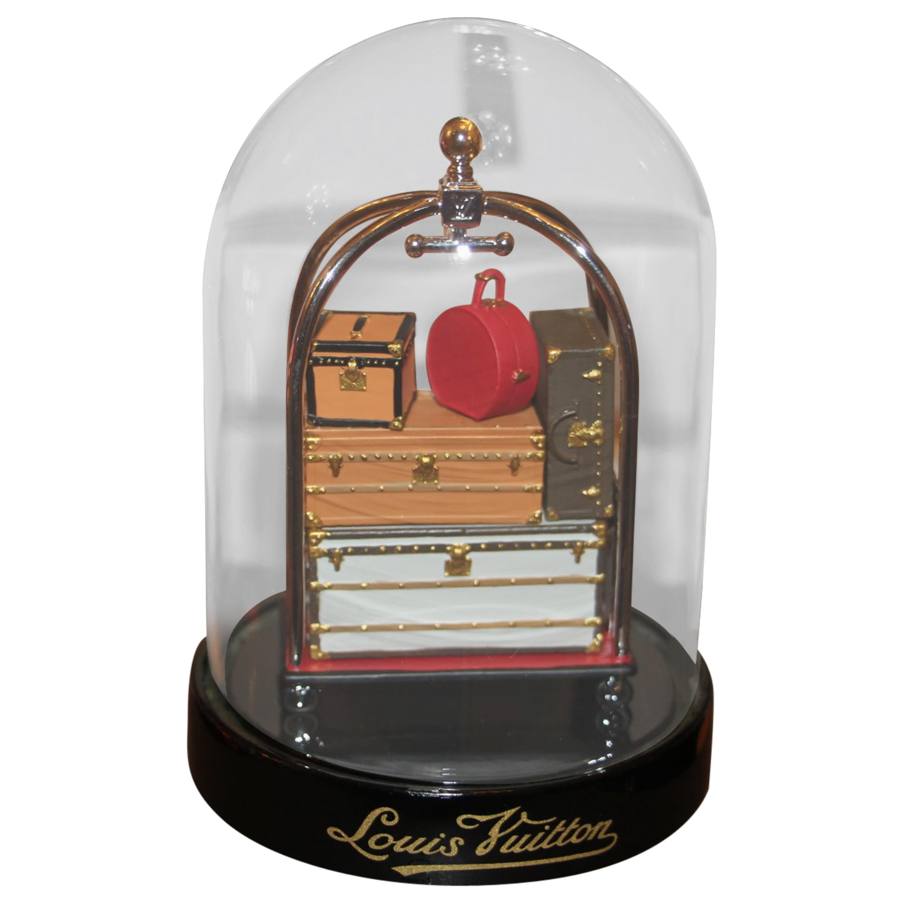 """""""The Trunk and Bag Trolley"""" Louis Vuitton Dome, Louis Vuitton Snow Globe,"""