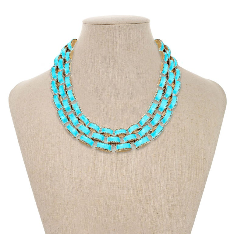 Introduced to CINER's line in the early 1990's, The Turquoise Brick Necklace is a fun accessory for every season.  Gorgeous hand-mixed turquoise enamel creates a bold yet wearable statement that offers a sublime look and feel. This piece was created