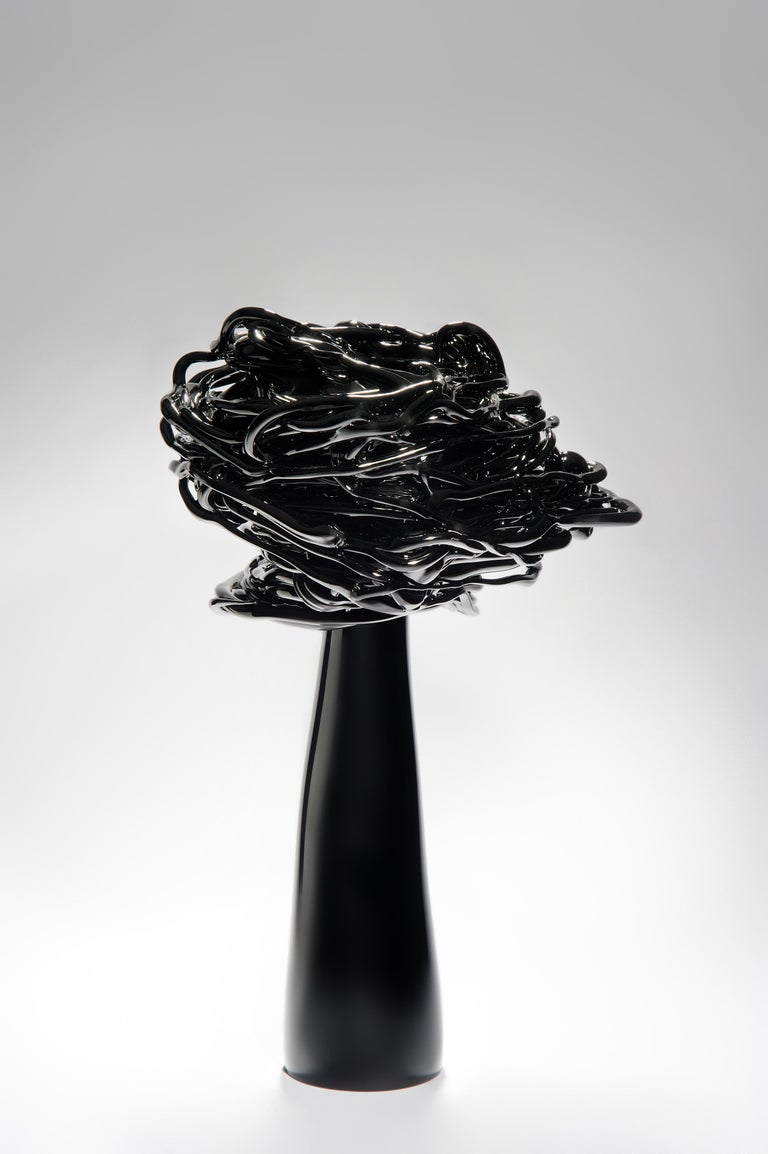 The Wind of Night, is a unique black glass stylized tree sculpture by the Lithuanian artist Remigijus Kriukas. Glass is blown and hot sculpted to create this substantial artwork, which is both striking and statuesque.