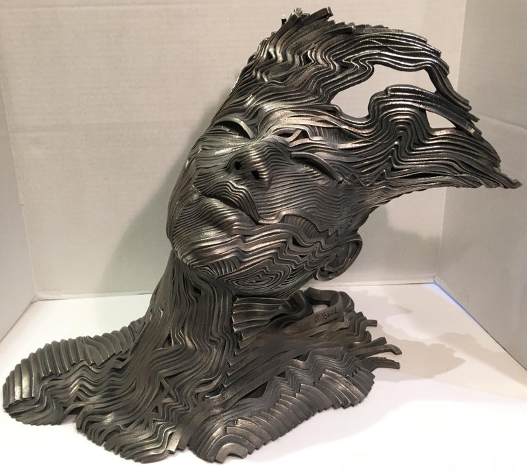 Dramatic, contemporary estate sculpture uses patinaed, unraveling ribbons of 316L grade stainless steel to evoke the sensation of wind on the skin.