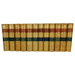 The Works of William Thackeray in 12 Tan Leather Bound Volumes with Gilt Spines