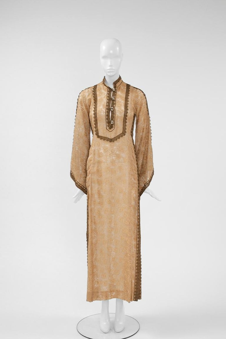 "Directly inspired from the Northern Africa traditional ""djellaba"", this late 60's - early 70's Thea Porter caftan is perfect for vacation or summer parties. Made from lightweight nude gazar (feels like silk gauze), this piece is intricately"