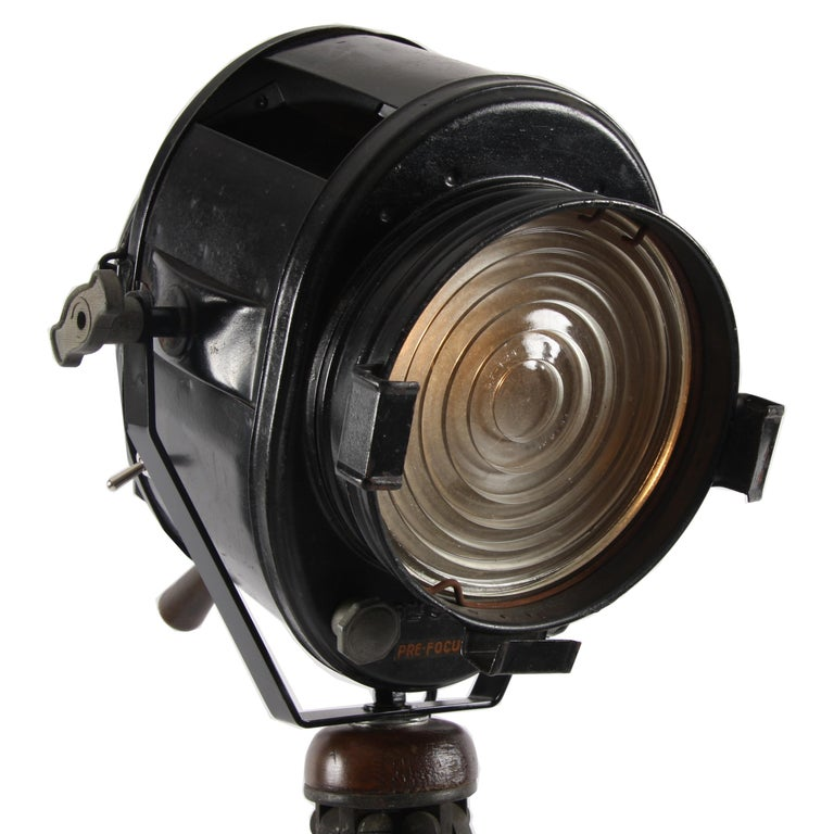 This gorgeous theatre light was made by A. E Cramer in Paris in the 1920s. It sits on a superb solid mahogany tripod Stand and the maker's mark is stamped on the back of the light itself.  A stunning piece!