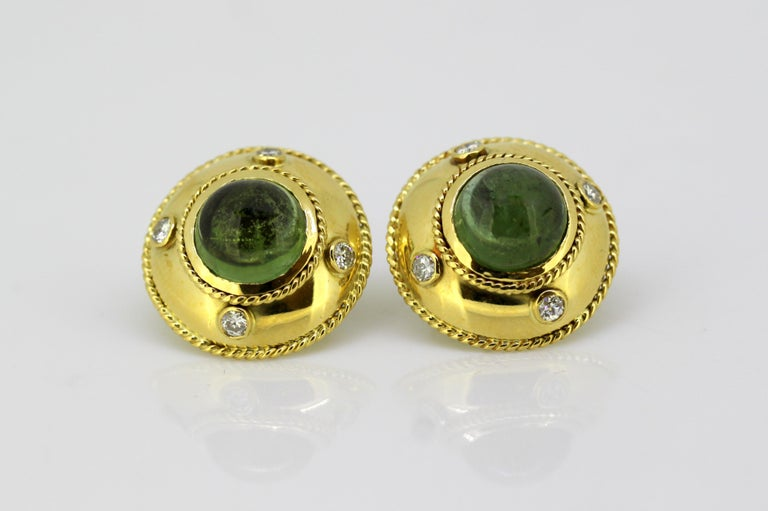18k gold ladies stud earrings with natural green tourmaline & diamonds.  Maker : Theo Fennell  Made in England Circa 1970's.   Dimensions -  Diameter x Depth : 2.1 x 2 cm  Weight : 17 grams   Green Tourmaline -  Cut : Round  Number of stones : 2