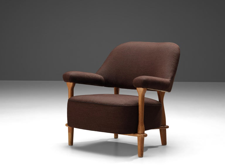 Theo Ruth for Artifort, lounge chair model 109, oak, brown fabric, the Netherlands, 1950s  The lounge chair model 109 was designed by Theo Ruth for Artifort in the 1950s. With an eye to the form and comfort, Ruth created an armchair that is