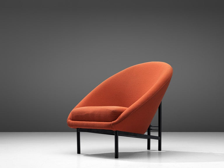 Theo Ruth for Artifort, easy chair, fabric and metal, The Netherlands, 1970  A Dutch easy chair in orange colored fabric by Theo Ruth. The back tilts slightly backward and has the recognizable natural flow and feel of Ruth's design. The frame of