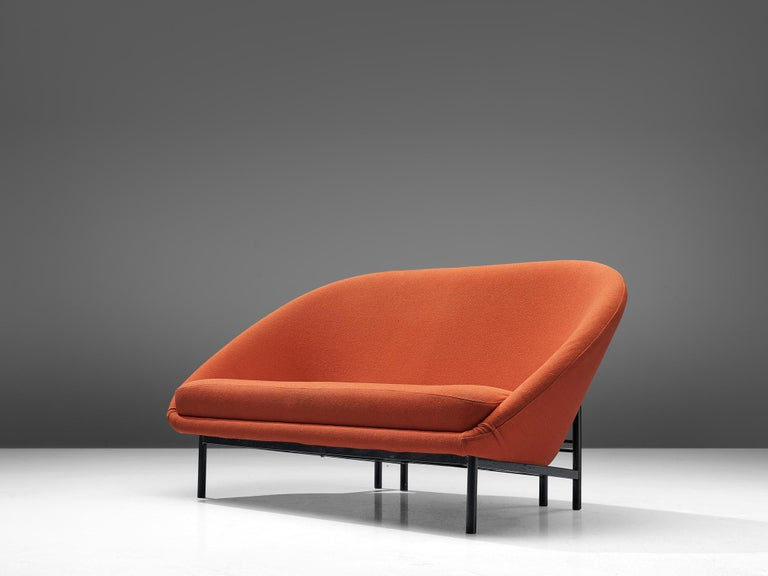 Theo Ruth for Artifort, two-seat sofa, fabric and metal, The Netherlands, 1970  A Dutch settee in orange colored fabric by Theo Ruth.The back tilts slightly backward and has the recognizable natural flow and feel of Ruth's design. The frame of