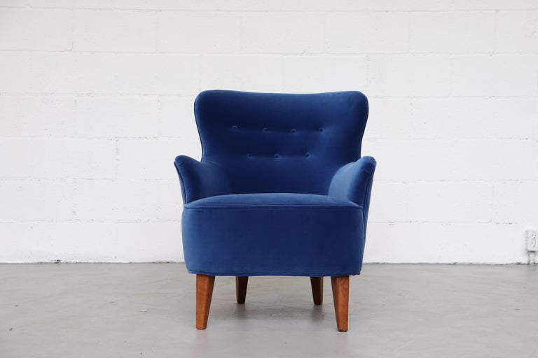Theo Ruth lounge armchair for Artifort in brand new cobalt blue velvet upholstery. Lightly refinished Tapered legs.