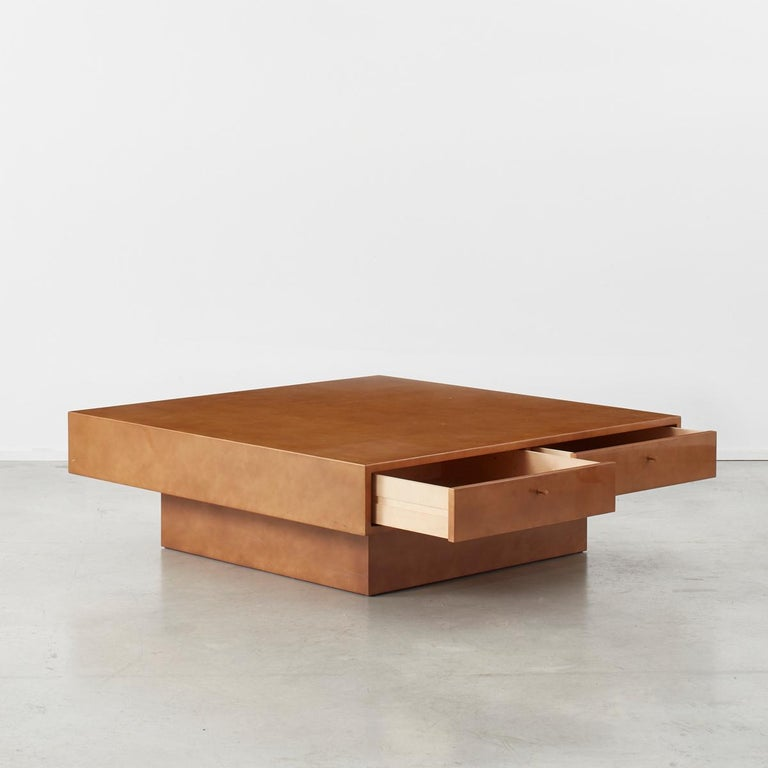 This is a one off piece designed by Theo Schulmann for his home, acquired from his personal collection. It sits on a recessed base giving it a light touch. The table is simple in form with a thick relaqué top concealing four draws, each with