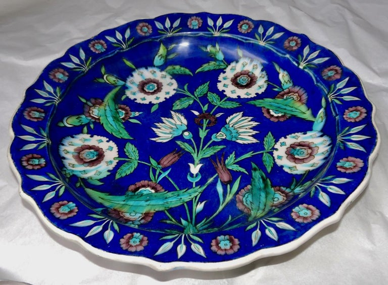 A fretted enameled Faience impressive charger