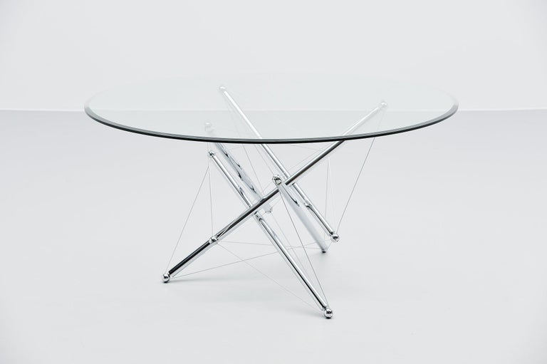 Sculptural dining table model 714 designed by Theodore Waddell and manufactured by Cassina, Italy, 1973. The coffee table has a very nice sculptural base with chrome metal tubes connected with metal wires. By turning the tubes you can adjust the