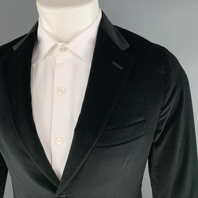 THEORY sport coat comes in black velvet with a notch lapel, single breasted, two button front, and single vented back. Made in Italy.  Excellent Pre-Owned Condition. Marked: 38 R  Measurements:  Shoulder: 15 in. Chest: 40 in. Sleeve: 25 in. Length: