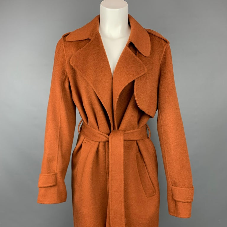 THEORY coat comes in a rust wool / cashmere featuring a shawl collar, slit pockets, epaulettes, belted, and a open front.   Very Good Pre-Owned Condition. Marked: M Original Retail Price: $595.00  Measurements:  Shoulder: 17 in. Bust: 40 in. Sleeve: