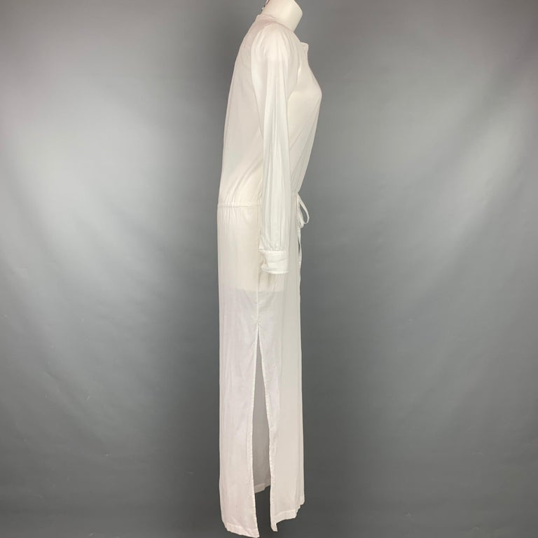 THEORY dress comes in a white cotton featuring a nehru collar, drawstring, front pocket, slits, and a buttoned closure. Comes with tags.  Good Pre-Owned Condition. Light discoloration at front & back. Marked: P/TP Original Retail Price: