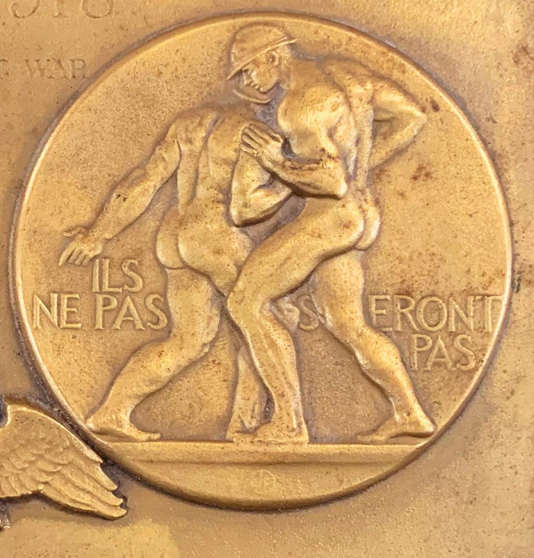 Honoring one of the most remarkable memorials to be issued after World War I, and perhaps the crowning achievement of America's greatest medallist and relief sculptor in the early 20th century, this unique bronze panel depicts both sides of a bronze