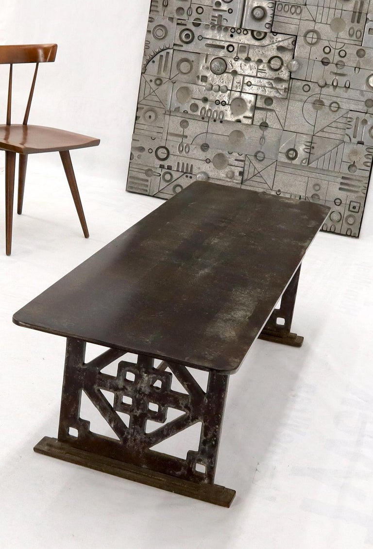 Studio signed and dated 1992 thick carved steel plate base rectangular coffee table with thick steel plate top. Good addition to Paul Evans or Laverne Decor.