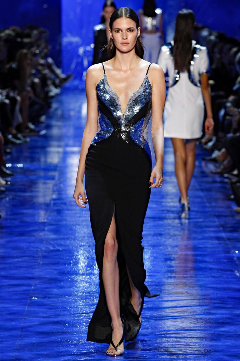 Quite substantial.  Very dramatic.  And Sold Out!   Impressive Mugler beaded color way of silver, pale and sapphire blue butterfly wings inspired bodice.  Plunging neckline includes additional snap panel for modesty if desired.     Spaghetti straps