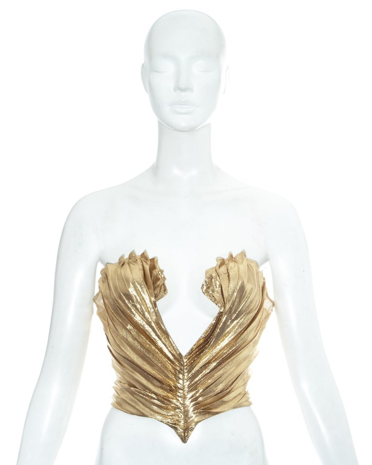 Thierry Mugler gold lamé corset bustier with scalloped edge, pleating throughout and low cleavage. Designed to cinch the waist and push the breasts up  Fall-Winter 1978