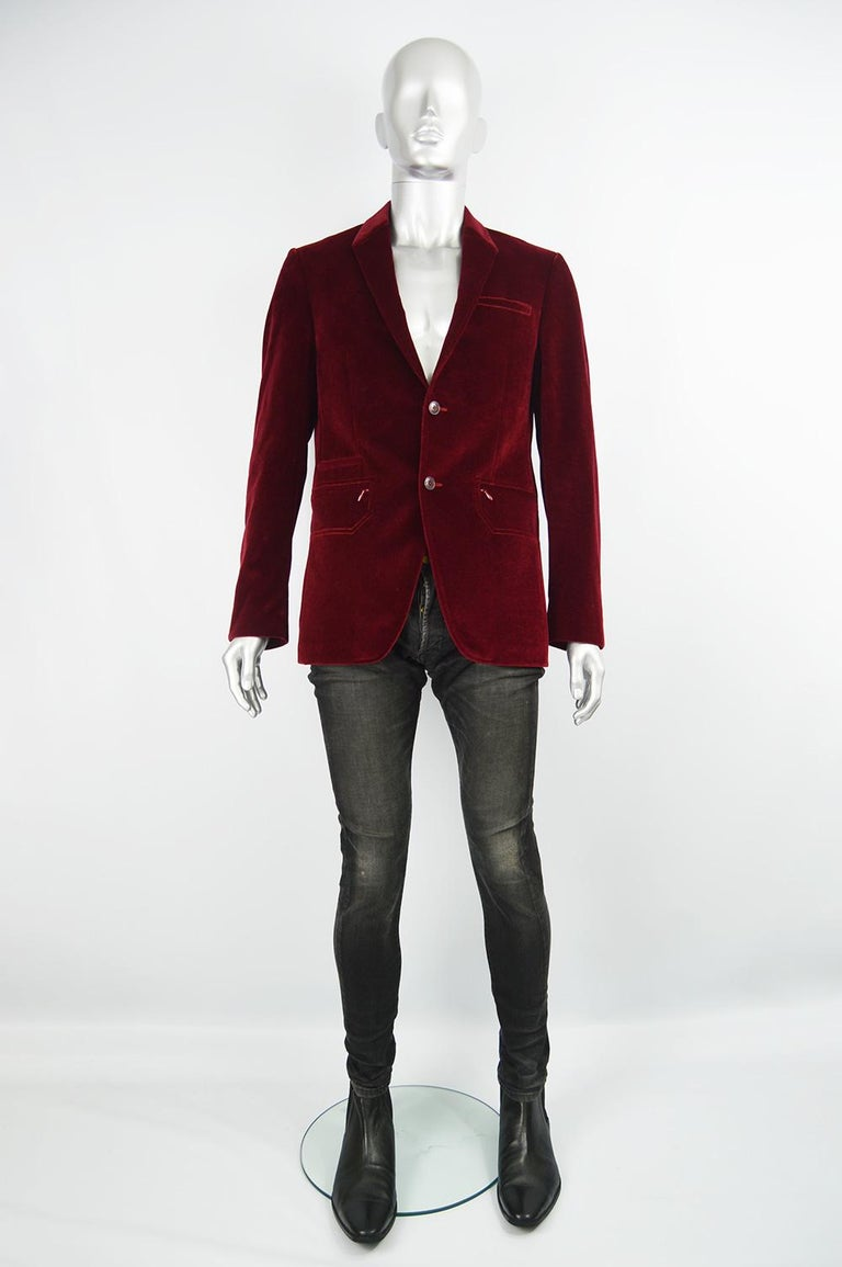 A stylish vintage Thierry Mugler jacket from the 90s in a deep red velvet with geometric shaped zip pockets, single breasted buttons and unique lapels.   Size: Marked IT 50 which is roughly a men's Medium to Large. Please check measurements.  Chest