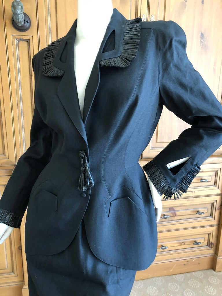 Thierry Mugler Vintage 1980's Black Suit with Raffia Fringe Tassel and Trim . Classic Mugler from the eighties.  Featuring a jacket and skirt. Size 38 Bust 38