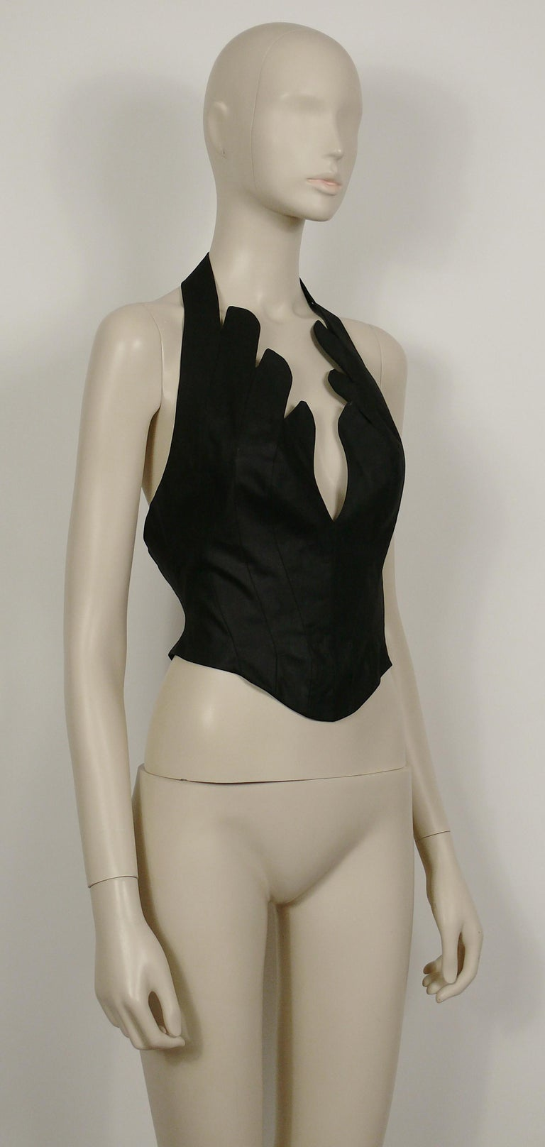 THIERRY MUGLER vintage iconic black coated cotton bustier corset with scalloped edges.  Snap button closure on the halter strap. Hook and eye loop closure at the back.  Label reads THIERRY MUGLER Paris. Made in France.  Size tag reads : 40. Please