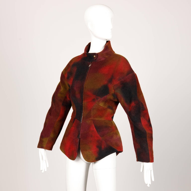 Rare vintage Thierry Mugler hand dyed wool jacket with a futuristic shape and avant garde construction. The jacket zips up the front and snaps at the neck. Fully lined. The marked size is 40, and the jacket fits like a modern small-medium. The bust