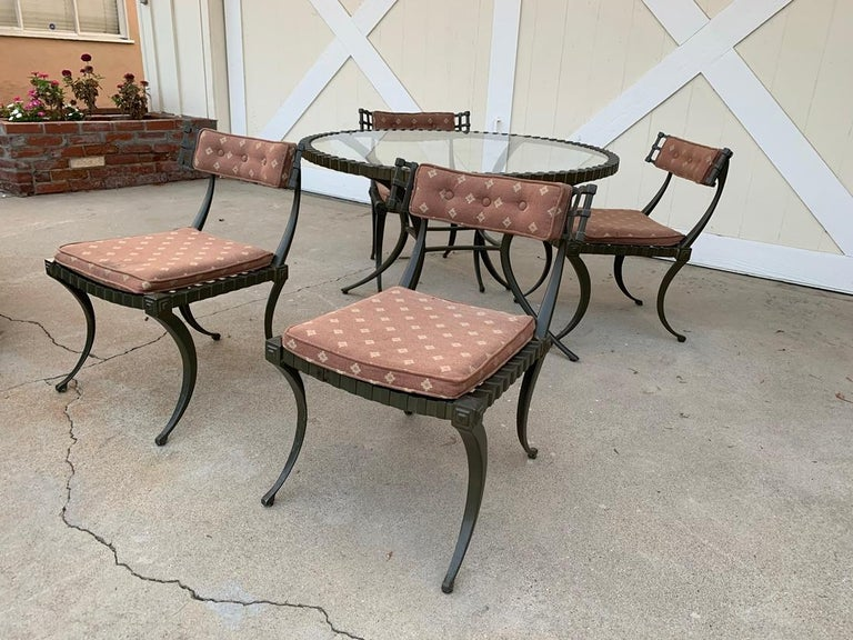 Thinline cast aluminum Klismos dining set. Table and four chairs. Table measures: 43 3/4