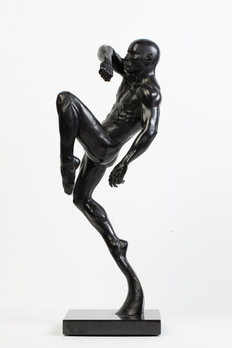 This is an extraordinary black bronze sculpture of a male Muay Thai fighter t by artist Dean Kugler. Attention to detail and complete understanding of the human figure are evident. The sculpture is beautifully custom mounted on a stone base. The