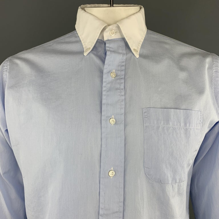 THOM BROWNE long sleeve shirt comes in a light blue cotton featuring a button down style, french cuffs, and a front patch pocket. Made in USA.   Excellent Pre-Owned Condition. Marked: (No size)   Measurements:   Shoulder: 18 in. Chest: 47