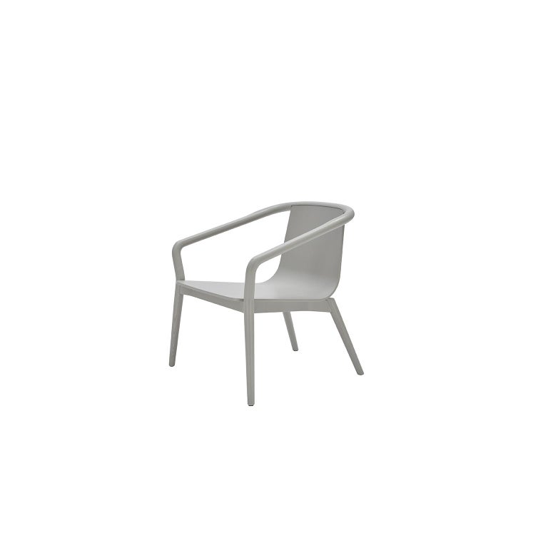 The Thomas armchair is derived from the same design elements as its namesake dining chair, featuring a formed plywood shell suspended in a solid ash frame with the distinctive carved armrest detail.  The proportions are modest, ensuring
