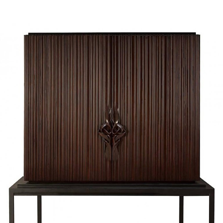 Bar Thomas with structure in solid mahogany wood, totally hand-crafted, hand-carved wood. Base in black satin solid wood. Inside in coral lacquered solid wood mahogany. With inside back in mirror glass, two drawers in handcrafted coral lacquered