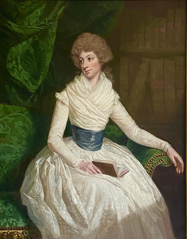 English 18th century Portrait of a Lady seated in a Library with a book - Painting by Thomas Beach