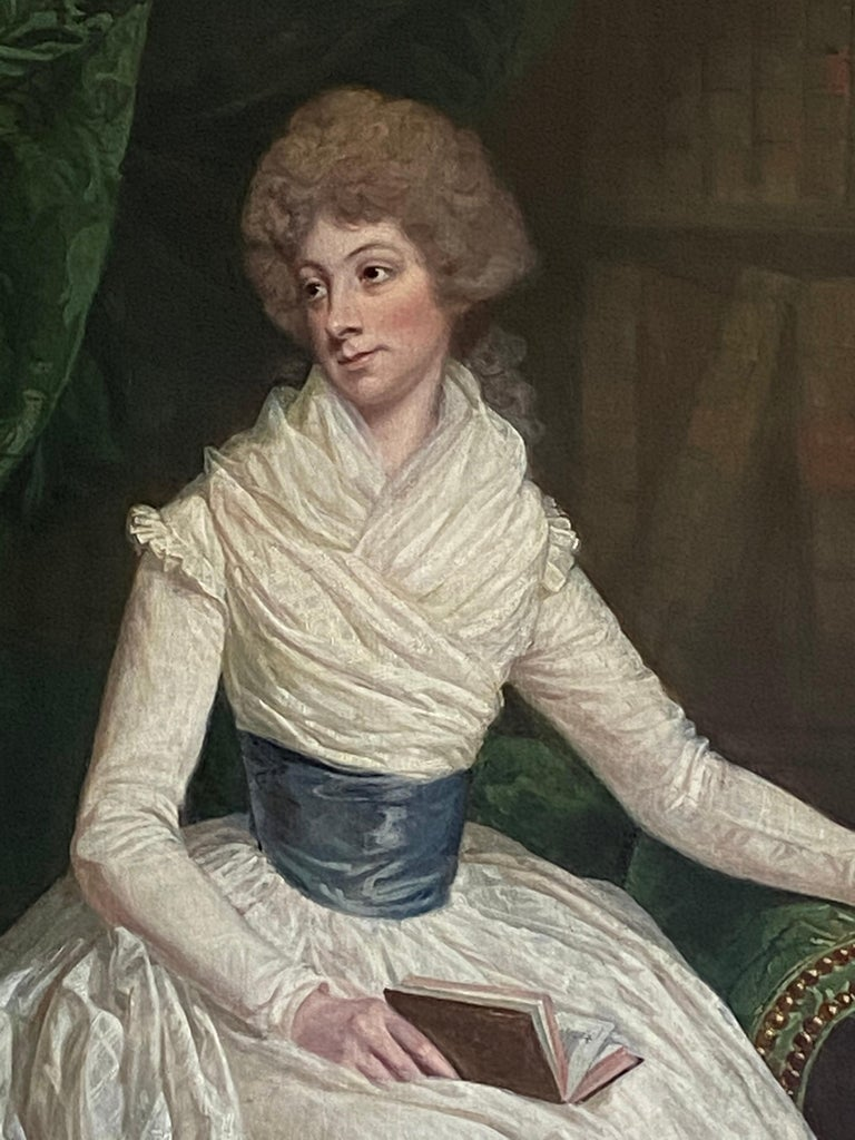 English 18th century Portrait of a Lady seated in a Library with a book - Old Masters Painting by Thomas Beach